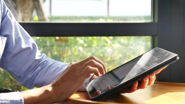 Businessman Using Digital Tablet tracking shot