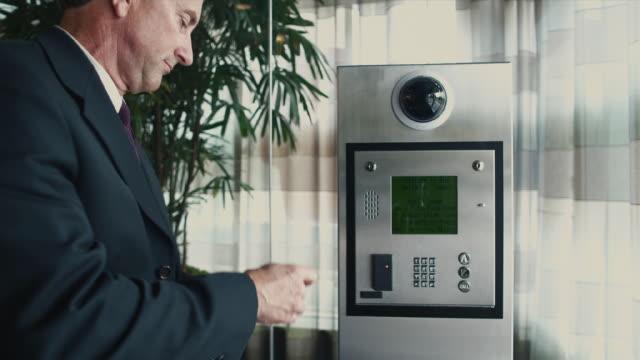 MS Businessman using keyless entry in lobby / Bellevue, Washington, USA