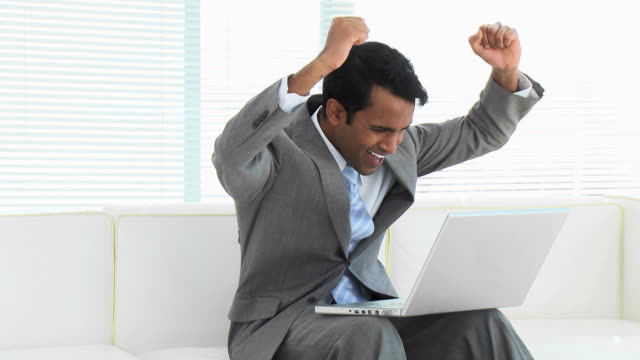 MS Businessman using laptop and gesturing / Cape Town, South Africa