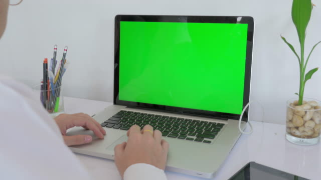 Businessman using on computer laptop with green screen,Dolly shot