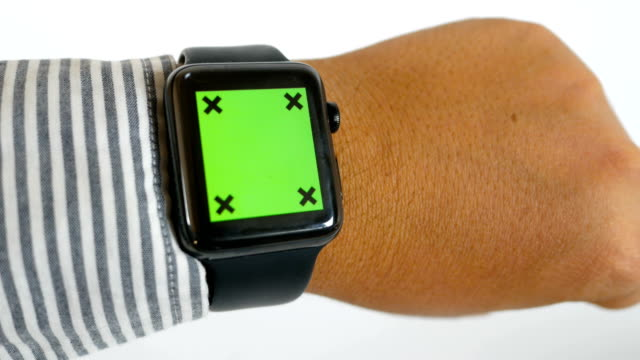 Businessman using smart watch with green screen on white background, chroma key