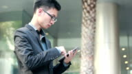 Businessman using tablet for business.