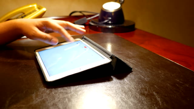 Businessman using tablet on classic wood table