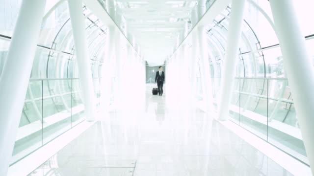 WS Businessman walking through modern building.