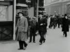 A businessman walks along a street in central London 1957