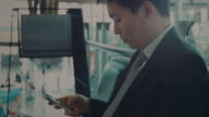 Businessman with cell phone at Station