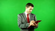 Businessman with clipboard in front of Green Screen
