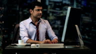 MS Businessman with hands clasped working on computer in office