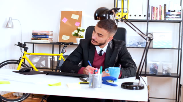 Businessman working alone in office