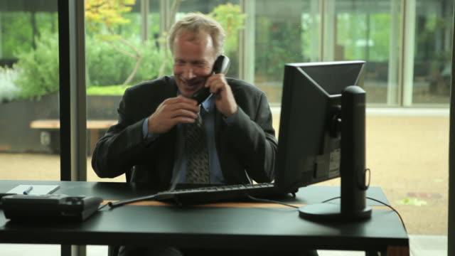 MS PAN Businessman working at desk / Portland, Oregon, USA