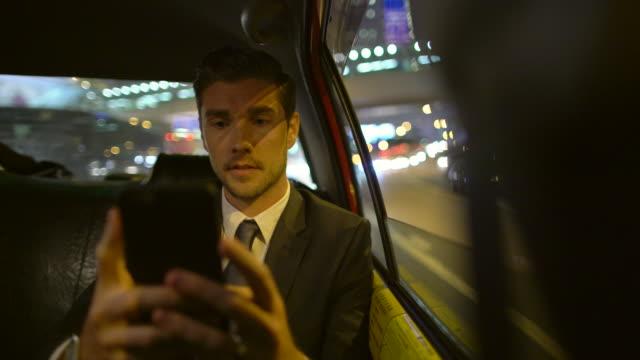 MS TS businessman working in a car at night, Hong Kong