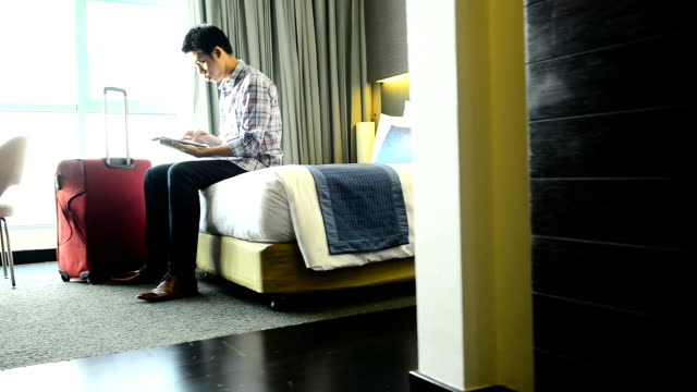 Businessman working on laptop and smartphone in the hotel