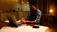 Businessman working on laptop at home, Delhi, India