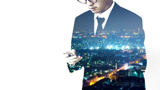 Businessman working with smart phone and time lapse background