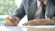 HD : Businessman writing on document