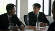 MS SELECTIVE FOCUS Businessmen and woman talking at meeting / China