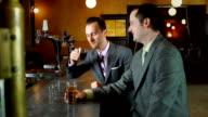 Businessmen having conversation in bar