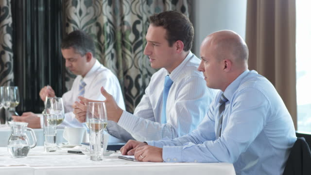 HD DOLLY: Businessmen Reviewing Results During Lunch