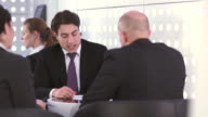 HD DOLLY: Businessmen Talking At The Table