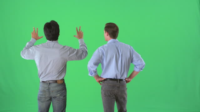 Businessmen talking in business casual attire on greenscreen