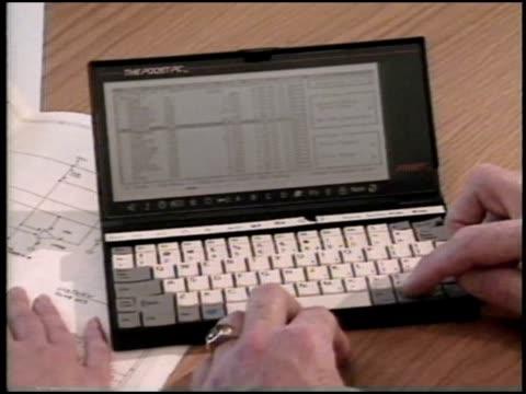 Businessmen using a Poqet PC