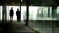 Businessmen walking away from camera