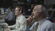 CU Businessmen working in television studio control room / Culver City, California, USA