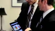 Businessmen Working on Tablet HD