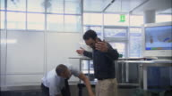 MS PAN Businesspeople going through airport security checkpoint/ Munich, Germany