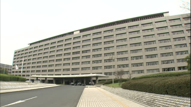 Businesspeople leave the Fukuoka Prefectural Government office building.