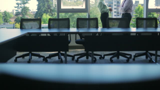 WS TU Businesspeople talking in boardroom / Vancouver, British Columbia, Canada