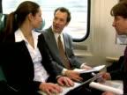 SLO MO, CU, Businesspeople working in train, Chappaqua, New York State, USA
