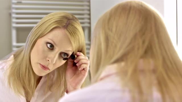 CU Businesswoman Applying Eye Mascara
