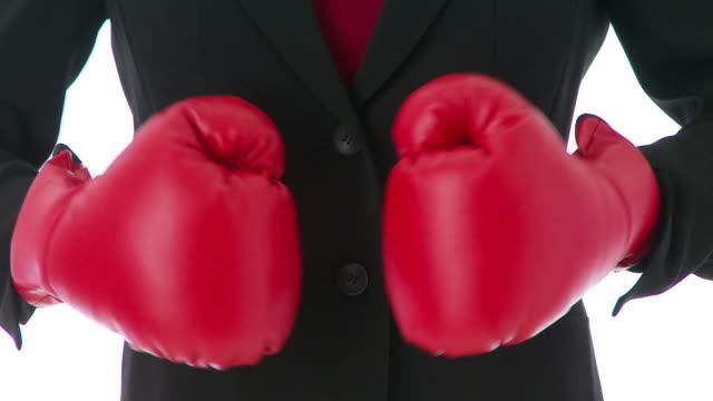 Businesswoman boxing