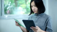 Businesswoman checking account on Digital Tablet