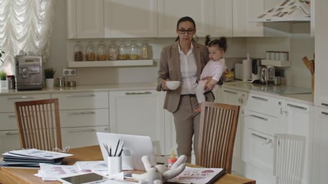 Businesswoman combining motherhood and work
