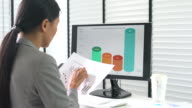 Businesswoman developing a business project and analyzing market data