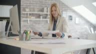 Businesswoman Doing Paperwork
