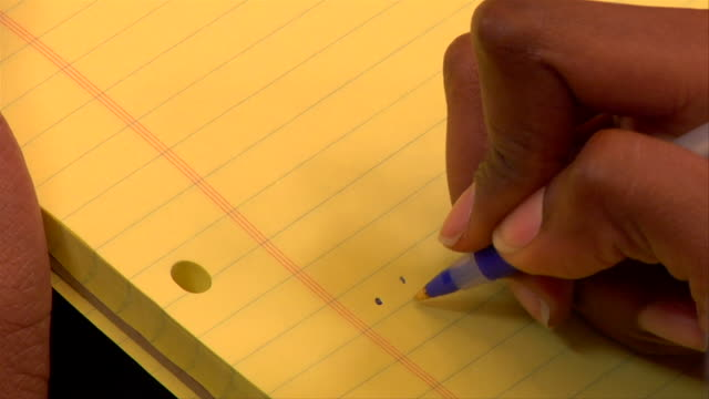 CU, Businesswoman drawing in notepad, close-up of hand