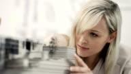 Businesswoman examine architecture model
