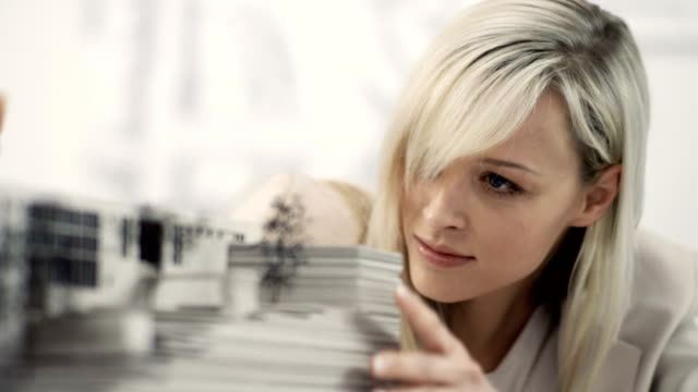 Businesswoman examine architecture model