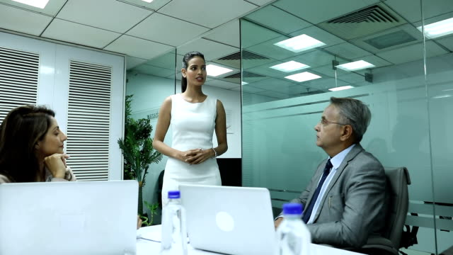 Businesswoman giving presentation in the office, Delhi, India