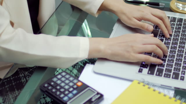 Businesswoman hands typing on laptop keyboard