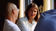 CU Businesswoman in discussion with colleagues during informal office meeting