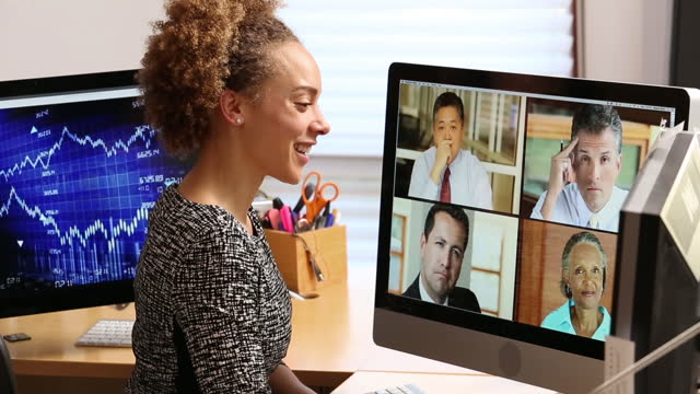 businesswoman in office having a video conference