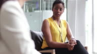 Businesswoman listening in a meeting