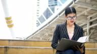 DS MS businesswoman looking paperwork