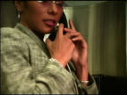 Businesswoman on pay phone