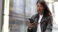 Businesswoman outdoors using smartphone