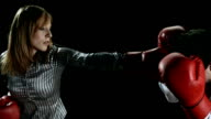HD SLOW MOTION: Businesswoman Punching Her Colleague